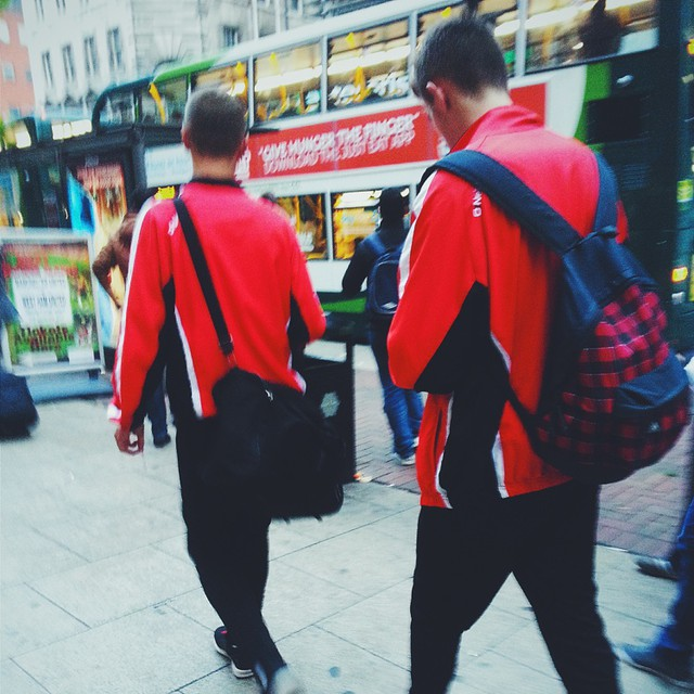 Footballers walking to Piccadilly