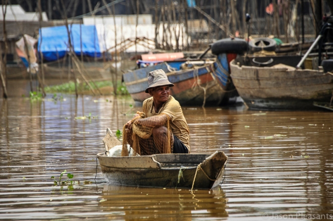 3) fisherman sitting in boat