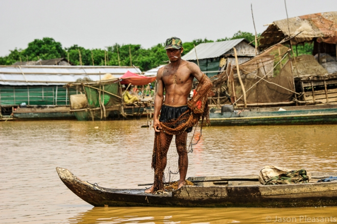 6) fisherman with net standing in boat